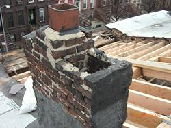 DAMAGED ROOFTOP CHIMNEY